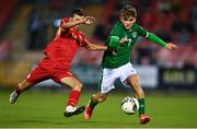 10 October 2021; Kevin Zefi of Republic of Ireland in action against Andrej Arizankoski of North Macedonia during the UEFA U17 Championship Qualifying Round Group 5 match between Republic of Ireland and North Macedonia at Turner's Cross in Cork. Photo by Eóin Noonan/Sportsfile
