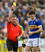 10 October 2021; Referee Mark O'Neill shows a yellow card to Gerard Walsh of O'Donovan Rossa during the Antrim County Senior Club Hurling Championship Final match between Dunloy and O'Donovan Rossa at Corrigan Park in Belfast. Photo by Ramsey Cardy/Sportsfile