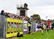 10 October 2021; Ciaran Orchin of O'Donovan Rossa takes a sideline cut during the Antrim County Senior Club Hurling Championship Final match between Dunloy and O'Donovan Rossa at Corrigan Park in Belfast. Photo by Ramsey Cardy/Sportsfile