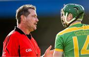 10 October 2021; Referee Mark O'Neill in conversation with Conal Cunning of Dunloy during the Antrim County Senior Club Hurling Championship Final match between Dunloy and O'Donovan Rossa at Corrigan Park in Belfast. Photo by Ramsey Cardy/Sportsfile