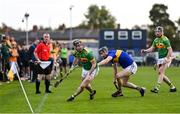 10 October 2021; Ryan McGarry of Dunloy in action against Gerard Walsh of O'Donovan Rossa during the Antrim County Senior Club Hurling Championship Final match between Dunloy and O'Donovan Rossa at Corrigan Park in Belfast. Photo by Ramsey Cardy/Sportsfile
