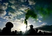 10 October 2021; A Dunloy supporter holds a flare after the Antrim County Senior Club Hurling Championship Final match between Dunloy and O'Donovan Rossa at Corrigan Park in Belfast. Photo by Ramsey Cardy/Sportsfile