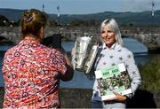 11 October 2021; Maria Croke O'Sullivan holds the Liam MacCarthy cup as she is photographed by her Limerick City and County Council colleague Yvonne Daly at the launch of 'Back 2 Back' at Limerick City and County Council offices at Merchants Quay in Limerick. Photo by Ray McManus/Sportsfile