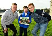 11 October 2021; Fergal Archer, 5th class student in Our Lady Queen of Peace Primary School, after receiving a gift of a book from Limerick hurlers Peter Casey, left, and William O'Donoghue at the launch of 'Back 2 Back' at Limerick City and County Council offices at Merchants Quay in Limerick. Photo by Diarmuid Greene/Sportsfile