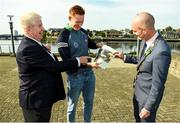 11 October 2021; Sportsfile photographer Ray McManus, left, Limerick hurler William O'Donoghue and Cllr Daniel Butler, Mayor of the City and County of Limerick, right, look at a photo of O'Donoghue at the launch of 'Back 2 Back' at Limerick City and County Council offices at Merchants Quay in Limerick. Photo by Diarmuid Greene/Sportsfile