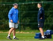 11 October 2021; Contact skills coach Denis Leamy speaks with Senior performance analyst Brian Colclough during a Leinster Rugby squad training session at UCD in Dublin. Photo by Harry Murphy/Sportsfile