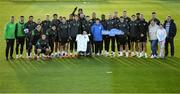 11 October 2021; Republic of Ireland manager Stephen Kenny and players pose for a photograph with Liam Mooney and his family, from Malin Head, Donegal, during a Republic of Ireland training session at the FAI National Training Centre in Abbotstown, Dublin. Liam got the opportunity to meet the Republic of Ireland team after the Make-A-Wish granted his wish to meet the Republic of Ireland team. Make-A-Wish is a Children's Charity which grants the wishes of children with life-threatening medical conditions to give hope, strength and joy. Photo by Stephen McCarthy/Sportsfile