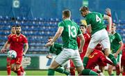 12 October 2021; Mark McGuinness of Republic of Ireland heads at goal during the UEFA European U21 Championship Qualifier Group F match between Montenegro and Republic of Ireland at Gradski Stadion Podgorica in Podgorica, Montenegro. Photo by Filip Roganovic/Sportsfile