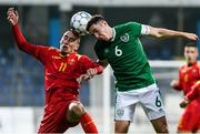 12 October 2021; Conor Coventry of Republic of Ireland in action against Danilo Pesukic of Montenegro during the UEFA European U21 Championship Qualifier Group F match between Montenegro and Republic of Ireland at Gradski Stadion Podgorica in Podgorica, Montenegro. Photo by Filip Roganovice/Sportsfile