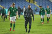12 October 2021; Republic of Ireland manager Jim Crawford, right, and Joel Bagan of Republic of Ireland after their defeat in the UEFA European U21 Championship Qualifier Group F match between Montenegro and Republic of Ireland at Gradski Stadion Podgorica in Podgorica, Montenegro. Photo by Filip Roganovic/Sportsfile