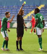 12 October 2021; Joshua Ogunfaolu-Kayode of Republic of Ireland is shown a yellow card by referee Barbeno Luca during the UEFA European U21 Championship Qualifier Group F match between Montenegro and Republic of Ireland at Gradski Stadion Podgorica in Podgorica, Montenegro. Photo by Filip Roganovic/Sportsfile