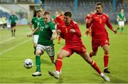 12 October 2021; Ross Tierney of Republic of Ireland in action against Anto Babic of Montenegro during the UEFA European U21 Championship Qualifier Group F match between Montenegro and Republic of Ireland at Gradski Stadion Podgorica in Podgorica, Montenegro. Photo by Filip Roganovic/Sportsfile