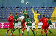 12 October 2021; Montenegro goalkeeper Nikola Ivezic and Mark McGuinness of Republic of Ireland compete for possession during the UEFA European U21 Championship Qualifier Group F match between Montenegro and Republic of Ireland at Gradski Stadion Podgorica in Podgorica, Montenegro. Photo by Filip Roganovic/Sportsfile