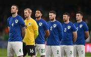 12 October 2021; The Republic of Ireland team, led by captain Shane Duffy, wear the Republic of Ireland jersey in 'St Patrick's Blue', which is being worn to celebrate the 100th anniversary of the Football Association of Ireland, while standing for Amhrán na bhFiann before the international friendly match between Republic of Ireland and Qatar at Aviva Stadium in Dublin. Photo by Sam Barnes/Sportsfile