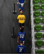12 October 2021; Republic of Ireland goalkeeper Caoimhin Kelleher makes his way out onto the pitch behind team captain Shane Duffy and ahead of team-mates Andrew Omobamidele and Matt Doherty before the international friendly match between Republic of Ireland and Qatar at Aviva Stadium in Dublin. Photo by Seb Daly/Sportsfile