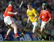 17 March 2004; Liam Richmond, Dunloy, in action against Philip Noonan, left, and Jerry O'Connor, Newtownshandrum. AIB All-Ireland Club Hurling Final, Newtownshandrum v Dunloy, Croke Park, Dublin, Picture credit; Brendan Moran / SPORTSFILE   *EDI*