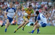 21 July 2013; Rory Kavanagh, Donegal, in action against Neil McAdam and Martin McElroy, left, Monaghan. Ulster GAA Football Senior Championship Final, Donegal v Monaghan, St Tiernach's Park, Clones, Co. Monaghan. Picture credit: Brian Lawless / SPORTSFILE
