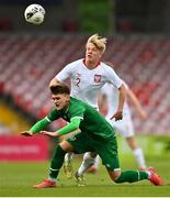 13 October 2021; Kevin Zefi of Republic of Ireland in action against Jakub Staniszewski of Poland during the UEFA U17 Championship Qualifying Round Group 5 match between Republic of Ireland and Poland at Turner's Cross in Cork. Photo by Eóin Noonan/Sportsfile