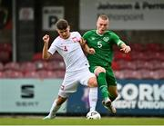 13 October 2021; Oliwier Slawinski of Poland is tackled by Cathal Heffernan of Republic of Ireland resulting in a penalty during the UEFA U17 Championship Qualifying Round Group 5 match between Republic of Ireland and Poland at Turner's Cross in Cork. Photo by Eóin Noonan/Sportsfile