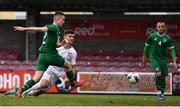 13 October 2021; Oliwier Slawinski of Poland scores his side's second goal despite the efforts of Luke Browne of Republic of Ireland during the UEFA U17 Championship Qualifying Round Group 5 match between Republic of Ireland and Poland at Turner's Cross in Cork. Photo by Eóin Noonan/Sportsfile