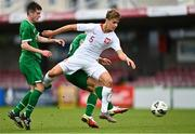 13 October 2021; Tomasso Guercio of Poland is tackled by Darius Lipsiuc of Republic of Ireland during the UEFA U17 Championship Qualifying Round Group 5 match between Republic of Ireland and Poland at Turner's Cross in Cork. Photo by Eóin Noonan/Sportsfile