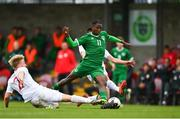 13 October 2021; Franco Umeh of Republic of Ireland is tackled by Jakub Staniszewski and Marcel Kalemba of Poland during the UEFA U17 Championship Qualifying Round Group 5 match between Republic of Ireland and Poland at Turner's Cross in Cork. Photo by Eóin Noonan/Sportsfile