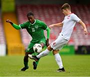 13 October 2021; Franco Umeh of Republic of Ireland in action against Bartosz Bernatowicz of Poland during the UEFA U17 Championship Qualifying Round Group 5 match between Republic of Ireland and Poland at Turner's Cross in Cork. Photo by Eóin Noonan/Sportsfile