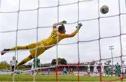13 October 2021; Justin Ferizaj of Republic of Ireland shoots to score his side's second goal despite the efforts of Poland goalkeeper Marcel Mendes-Dudzinski during the UEFA U17 Championship Qualifying Round Group 5 match between Republic of Ireland and Poland at Turner's Cross in Cork. Photo by Eóin Noonan/Sportsfile