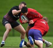 13 October 2021; Joey Carbery is tackled by Dave Kilcoyne and Keith Earls during Munster rugby squad training at the University of Limerick in Limerick. Photo by Brendan Moran/Sportsfile