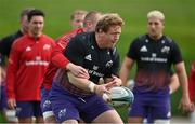 13 October 2021; Stephen Archer is tackled by Keith Earls during Munster rugby squad training at the University of Limerick in Limerick. Photo by Brendan Moran/Sportsfile