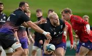 13 October 2021; Jeremy Loughman, centre, is tackled by Tadhg Beirne, left, and Mike Haley during Munster rugby squad training at the University of Limerick in Limerick. Photo by Brendan Moran/Sportsfile