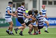 13 October 2021; Donie Grehan of Blackrock College is tackled by Ólan Storey, left, and Donnchadh Cullinan of Terenure College during the Bank of Ireland Leinster Schools Junior Cup semi-final match between Blackrock College and Terenure College at Energia Park in Dublin. Photo by Piaras Ó Mídheach/Sportsfile