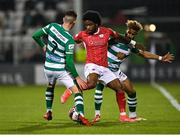 15 October 2021; Walter Figueira of Sligo Rovers in action against Dylan Watts, left, and Barry Cotter of Shamrock Rovers during the SSE Airtricity League Premier Division match between Shamrock Rovers and Sligo Rovers at Tallaght Stadium in Dublin. Photo by Seb Daly/Sportsfile