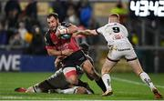 15 October 2021; Megiel Burger Odendaal of Emirates Lions is tackled by Matty Rea and Nathan Doak of Ulster during the United Rugby Championship match between Ulster and Emirates Lions at Kingspan Stadium in Belfast. Photo by Ramsey Cardy/Sportsfile
