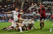15 October 2021; Nathan Doak of Ulster clears under pressure from Reinhard Nothnagel of Emirates Lions during the United Rugby Championship match between Ulster and Emirates Lions at Kingspan Stadium in Belfast. Photo by Ramsey Cardy/Sportsfile