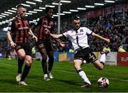 15 October 2021; Michael Duffy of Dundalk in action against Andy Lyons, left, and Promise Omochere of Bohemians during the SSE Airtricity League Premier Division match between Bohemians and Dundalk at Dalymount Park in Dublin. Photo by Ben McShane/Sportsfile
