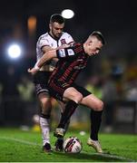 15 October 2021; Michael Duffy of Dundalk in action against Andy Lyons of Bohemians during the SSE Airtricity League Premier Division match between Bohemians and Dundalk at Dalymount Park in Dublin. Photo by Ben McShane/Sportsfile