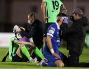 15 October 2021; Johnny Dunleavy of Finn Harps receives attention following a clash with Greg Halford of Waterford  during the SSE Airtricity League Premier Division match between Waterford and Finn Harps at the RSC in Waterford. Photo by Michael P Ryan/Sportsfile
