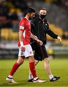15 October 2021; Robbie McCourt of Sligo Rovers leaves the field with physiotherapist Tom Duffy after an injury during the SSE Airtricity League Premier Division match between Shamrock Rovers and Sligo Rovers at Tallaght Stadium in Dublin. Photo by Seb Daly/Sportsfile