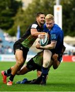 9 October 2021; Jamie Osborne of Leinster is tackled by Mattia Bellini, left, and Andrea Lovotti of Zebre during the United Rugby Championship match between Leinster and Zebre at RDS Arena in Dublin. Photo by Sam Barnes/Sportsfile