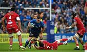 16 October 2021; James Ryan of Leinster evades the tackle of Tomas Lezana of Scarlets during the United Rugby Championship match between Leinster and Scarlets at the RDS Arena in Dublin. Photo by Ramsey Cardy/Sportsfile