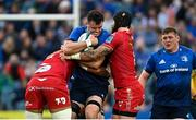 16 October 2021; James Ryan of Leinster is tackled by Sam Lousi, left, and Blade Thomson of Scarlets during the United Rugby Championship match between Leinster and Scarlets at the RDS Arena in Dublin. Photo by Ramsey Cardy/Sportsfile