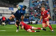 16 October 2021; Caelan Doris of Leinster is tackled by Ryan Conbeer of Scarlets during the United Rugby Championship match between Leinster and Scarlets at the RDS Arena in Dublin. Photo by Ramsey Cardy/Sportsfile