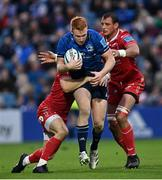 16 October 2021; Ciarán Frawley of Leinster is tackled by Ryan Conbeer and Blade Thomson of Scarlets during the United Rugby Championship match between Leinster and Scarlets at the RDS Arena in Dublin. Photo by Ramsey Cardy/Sportsfile