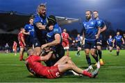 16 October 2021; Caelan Doris of Leinster is congratulated by team-mate Andrew Porter after scoring their side's fourth try during the United Rugby Championship match between Leinster and Scarlets at the RDS Arena in Dublin. Photo by Seb Daly/Sportsfile
