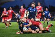 16 October 2021; Caelan Doris of Leinster dives over to score his side's fourth try, despite the tackle of Scarlets' Ioan Nicholas, during the United Rugby Championship match between Leinster and Scarlets at the RDS Arena in Dublin. Photo by Seb Daly/Sportsfile