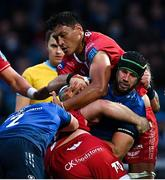 16 October 2021; Caelan Doris of Leinster is tackled by WillGriff John and Sam Lousi of Scarlets during the United Rugby Championship match between Leinster and Scarlets at the RDS Arena in Dublin. Photo by Ramsey Cardy/Sportsfile