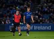 16 October 2021; Ciarán Frawley of Leinster leaves the field with head of medical Professor John Ryan following an injury during the United Rugby Championship match between Leinster and Scarlets at the RDS Arena in Dublin. Photo by Seb Daly/Sportsfile