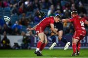 16 October 2021; Caelan Doris of Leinster offloads in the tackle by Johnny McNicholl of Scarlets during the United Rugby Championship match between Leinster and Scarlets at the RDS Arena in Dublin. Photo by Ramsey Cardy/Sportsfile
