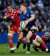 16 October 2021; Ciarán Frawley of Leinster is tackled by Ryan Conbeer of Scarlets during the United Rugby Championship match between Leinster and Scarlets at the RDS Arena in Dublin. Photo by Ramsey Cardy/Sportsfile
